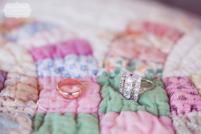 Wedding rings on a handmade colorful quilt for this winter wedding.