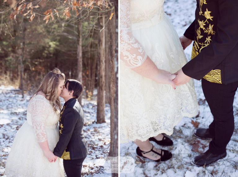 A queer couple kissing in snowy woods before their backyard barn wedding in mid-MO.