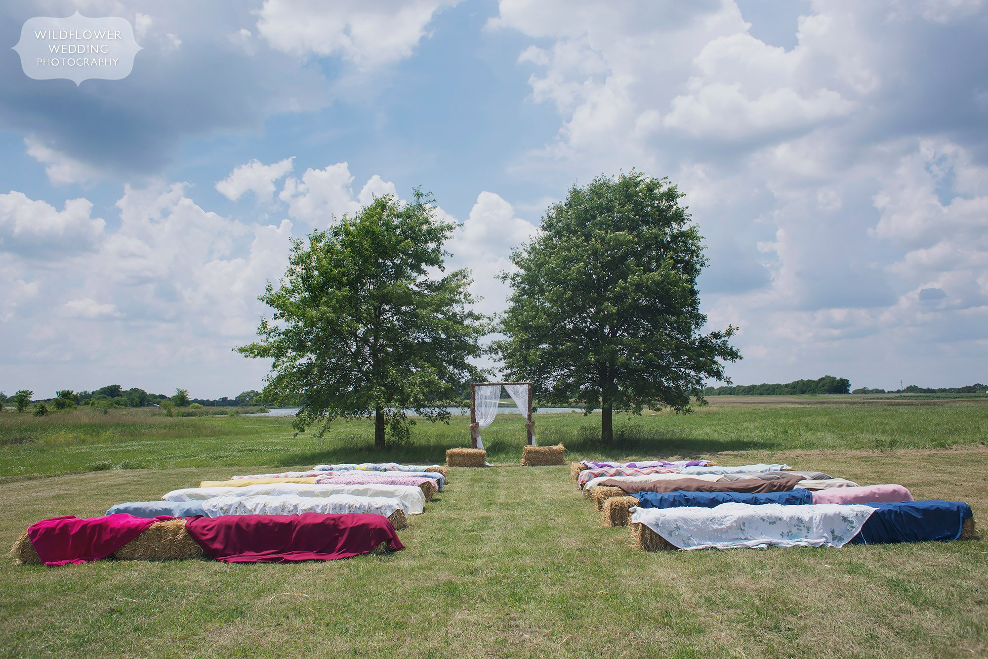 Great idea for a country wedding outdoor ceremony with quilts over hay bales at the MU Bradford Farm in Columbia.