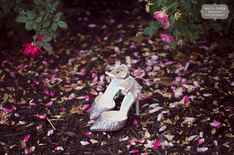 Bright and fun wedding photography of bride's Betsey Johnson pink sparkle shoes at the Jefferson City Country Club in MO.