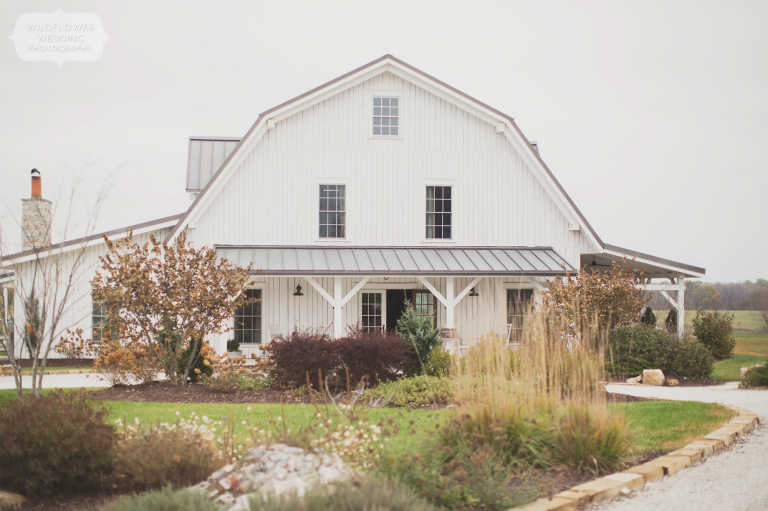 The white scandinavian style barn at the Blue Bell Farm wedding venue near Columbia, MO.