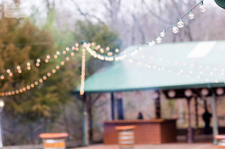 Romantic open pavilion at the Little Piney Lodge wedding venue with string cafe lights canopy in Hermann.