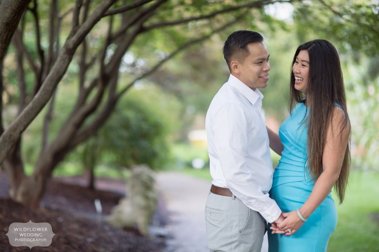 Happy couple during Shelter Gardens engagement photography session outside in summer.