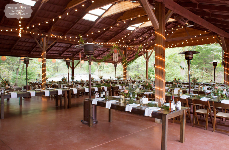 View of the inside of the Little Piney Lodge wedding pavilion with twinkle lights.