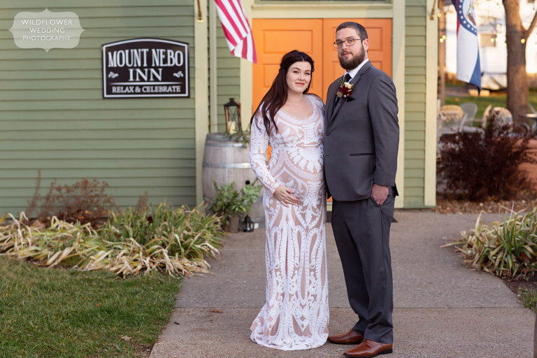 Bride and groom stand in front of the Mount Nebo Inn in Rocheport, MO.
