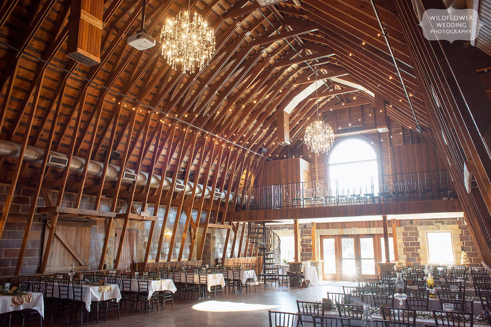 Inside view of the historic Brownstone Barn wedding reception space in Topeka, KS.