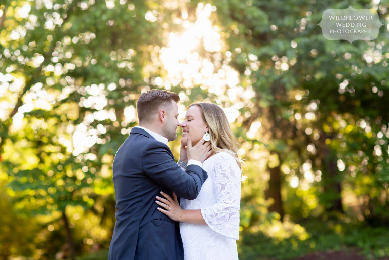 Couple stands in warm shimmering light for Columbia MO summer engagement photography session.