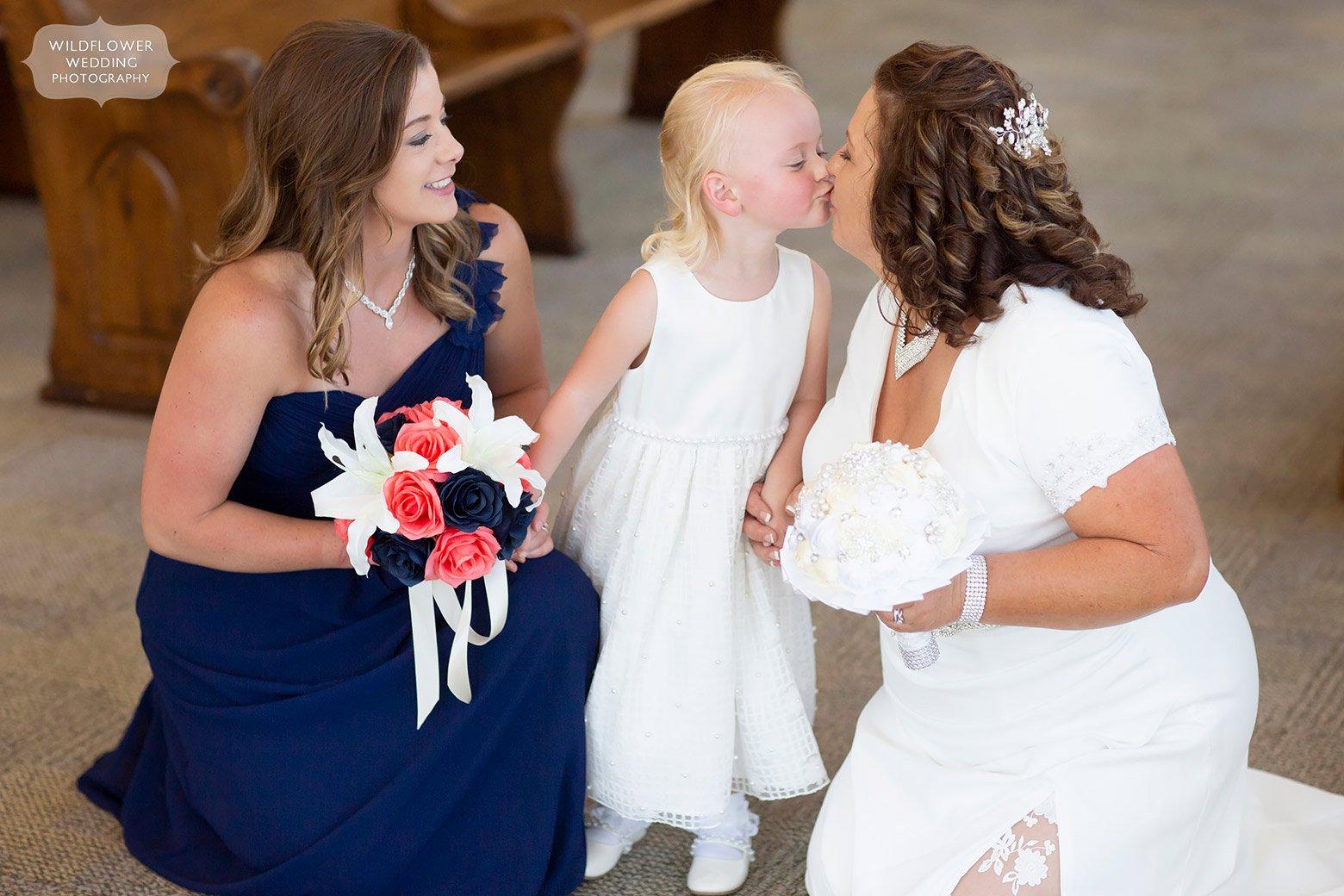 Candid wedding photographer captures Hermann Hill Weddings flower girl.